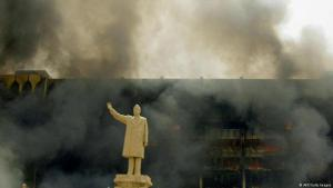 Smoke and fire in front of the Saddam Hussein status in Baghdad (photo: AFP)