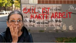 """Artist Nil Yalter in """"Walls""""; acrylic on offset print, Vietorstrasse, Cologne-Kalk. Exhibition """"Exile Is a Hard Job"""". Museum Ludwig 9 March - 2 June 2019 (photo: Nil Yalter/H. Krause)"""